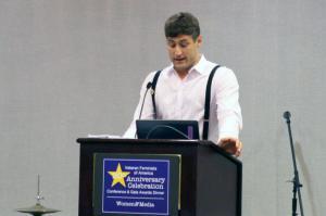 John Erickson presents award to David Dismore